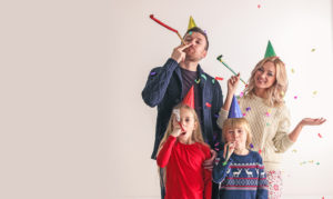 Family blowing party trumpets