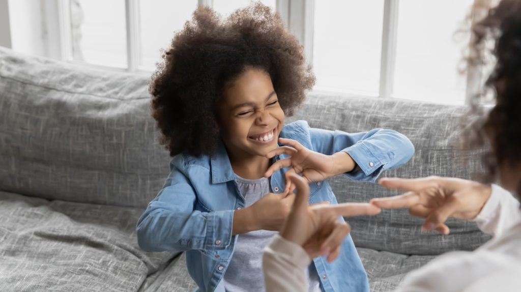 African little girl using sign language communicates with mom