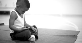 Child on yoga mat